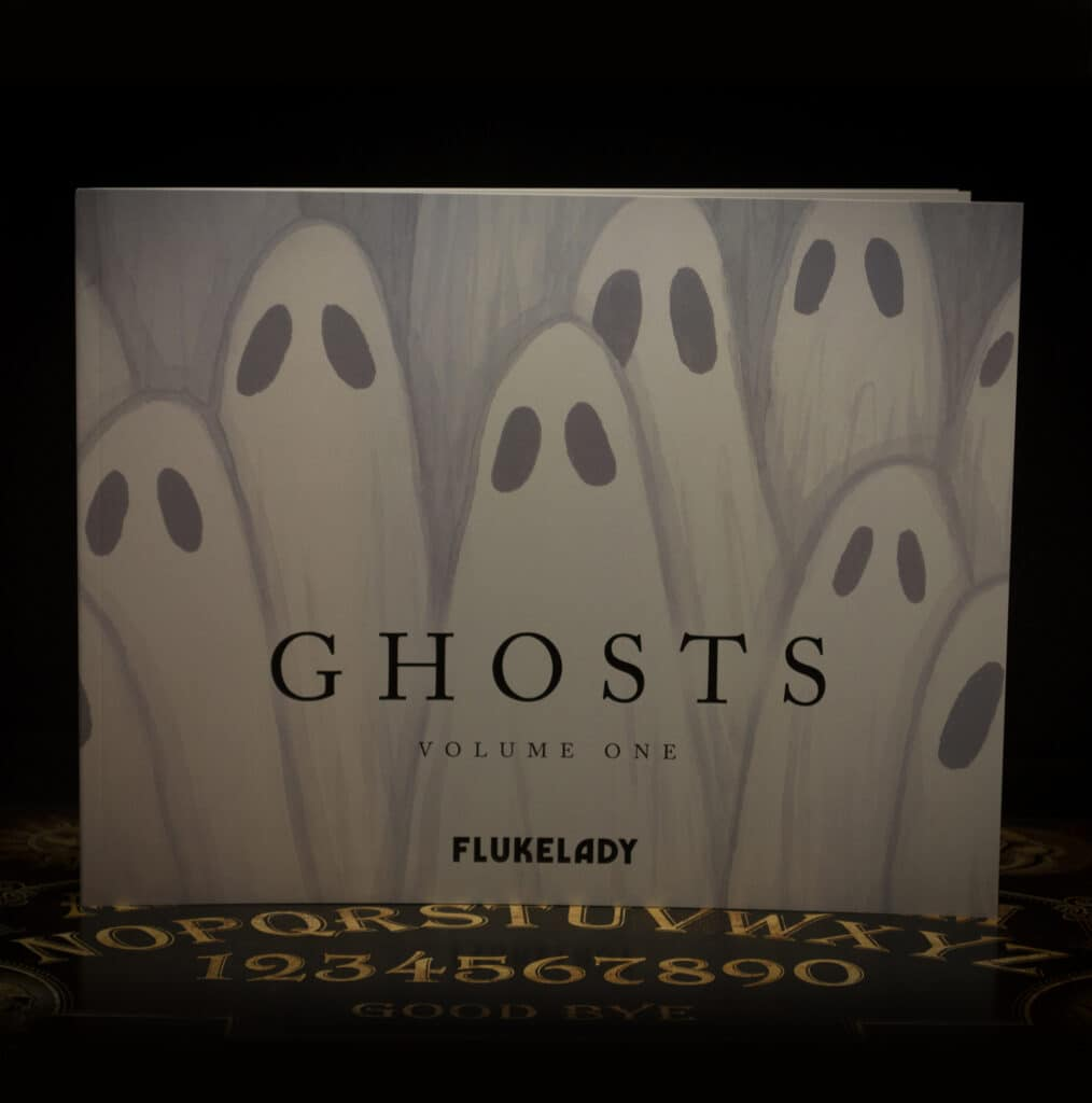 A photo of Ghosts Vol. 1 - All 31 works from Ghostober 2020 in one book.