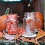 Flukelady's haunted refreshments ghost mugs in a fall setting.